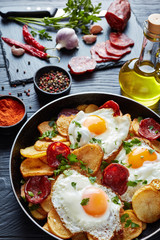 fried sunny side up eggs with potatoes