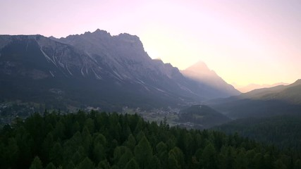 Fototapete - Scenic sunrise over Italian Dolomites near Cortina d'Ampezzo. Early morning shot of autumn mountains with colorful trees in first rays of sunlight.