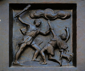"Thou shalt not kill - Cain and Abel, relief on the door of the Grossmunster (""great minster"") church in Zurich, Switzerland"