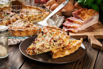 Pieces of quiche lorraine with bacon and cheese