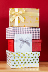 red background with batch of Christmas gift boxes