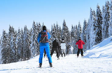 skiers descend