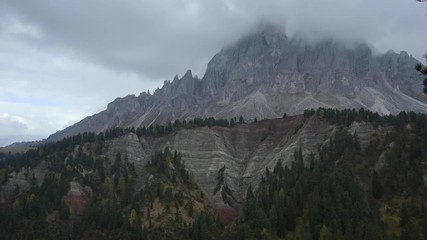 Fototapete - Colorful scenic view of majestic Dolomites mountains in Italian Alps. Majestic rocky mountains surrounded with yellow trees in autumn time.