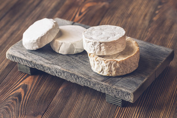 Heads of Camembert on the wooden board