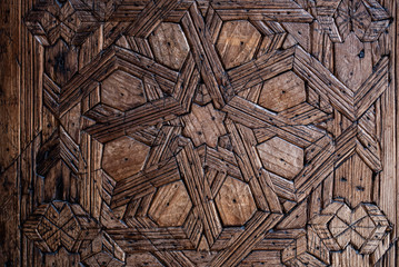 Details of a carved wood wall art geometrically handmade