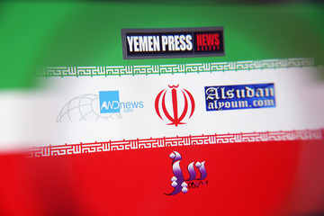 The logos for the Yemen Press News Agency, Sudan Today, Nile Net Online and AWDnews websites are seen against an Iranian flag in a picture illustration