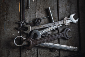 Group of wrenches on wood