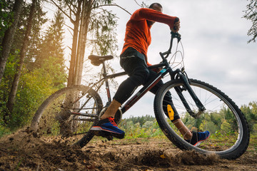 Athlete mountainbiking in the woods