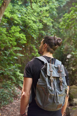 Spain, Canary Islands, La Palma, man walking with backpack in a forest