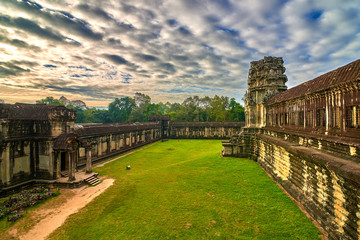View of Angkor Wat complex at sunrise, Archaeological Park in Siem Reap, Cambodia, UNESCO World Heritage Site and popular tourist attraction
