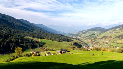Fototapete - Time lapse footage of pittoresque Val di Funes valley in Italian Dolomites.