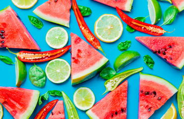Above view at Watermelon and Chili pepper with lemons on blue background