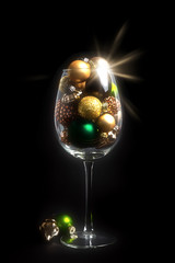 Christmas decoration wine glass on black background with glass balls