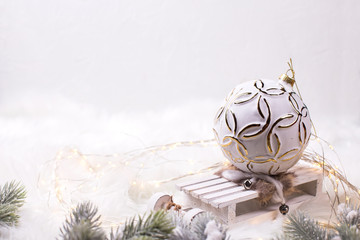 White ball  on slage on white fur background.