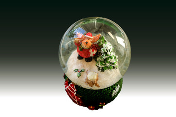 Christmas decoration: a dog in costume of santi and a Christmas tree in a ball