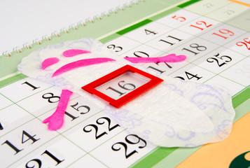 Women's sanitary napkin enjoys the beginning of the menstrual period. Menstrual calendar.