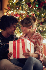 man and girl exchanging Christmas presents and enjoying in holidays.