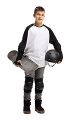 Young boy with protective equipment and a skateboard