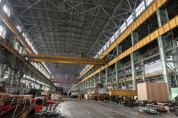 The interior of a big industrial building or factory with steel constructions