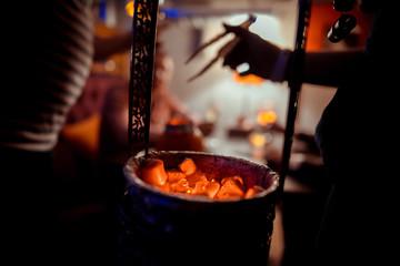 Coals for hookah in the bowl. shisha hookah red hot coals. red Coals for hookah