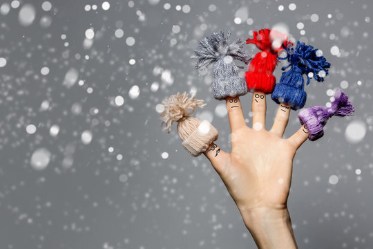 Christmas background with  funny finger family  over grey background with snow