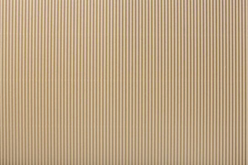 Texture of corrugated light beige paper, macro.