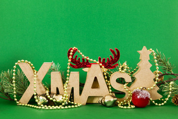 Christmas decoration with xmas text and a hidden reindeer