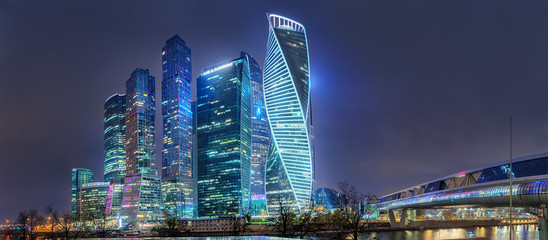 "Moscow - October 21, 2018: The towers of the international business center ""Moscow-City"" and Bridge Bagration. Night view from Taras Shevchenko embankment."