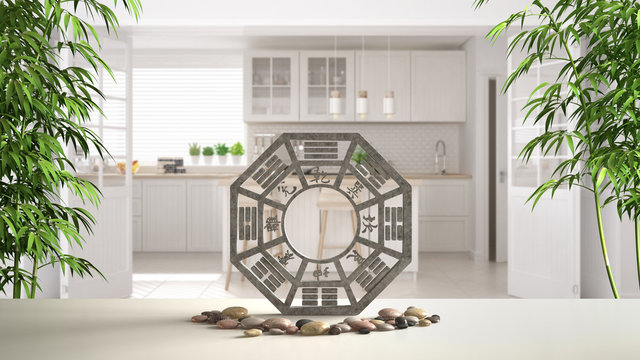 White table shelf with bagua, pebble stone and bamboo plants, white scandinavian kitchen with island and big door, zen concept interior design, feng shui template idea background