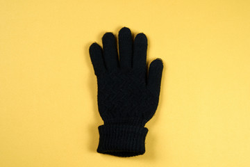 Winter Glove With Yellow Background
