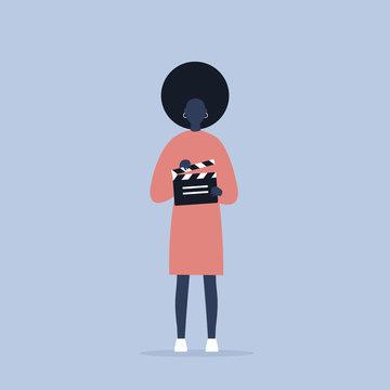 Camera crew. young black female assistant holding a clapperboard / editable flat vector cartoon illustration, clip art