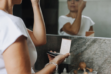 Woman putting on her make up