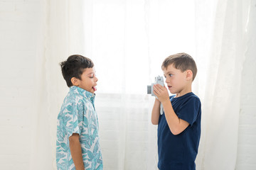 A Boy Takes A Photo Of His Friend