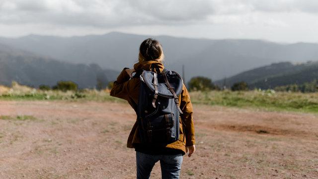 Young woman hiking through mountain