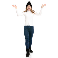 Beautiful woman in sweater jeans hat cold showing of positive emotions surprise on white background isolation
