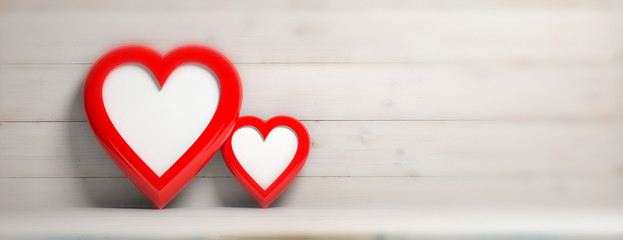Two red heart shaped empty frames on wooden wall background, banner