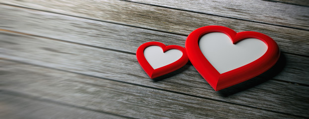 Two red heart shaped empty frames on wooden background, banner