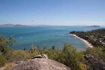 Scenic view of Magnetic Island against blue sky during sunny day