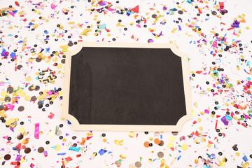 Blank chalk board with glitter and confetti