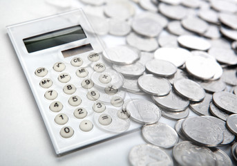 white calculator with russian ruble coins close up