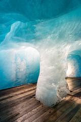 blue ice inside the rhone glacier, switzerland. climate change