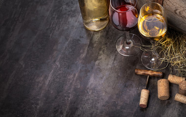 wine bottles and glass on table with copy space