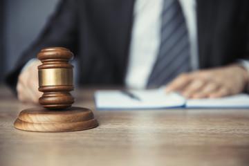 Man holding  judge