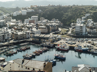 Aerial view of fishermen port close to city of Luarca, Spain