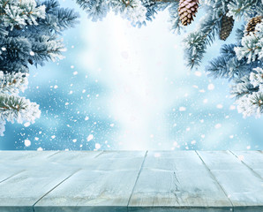 Merry Christmas and happy New, Year greeting background with table .Winter landscape with fir tree branch