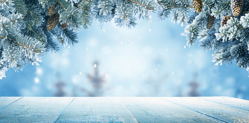 Wall Mural - Merry christmas and happy new year greeting background with copy-space.Winter landscape with snow and christmas trees
