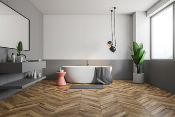Wooden floor bathroom interior, tub and sink