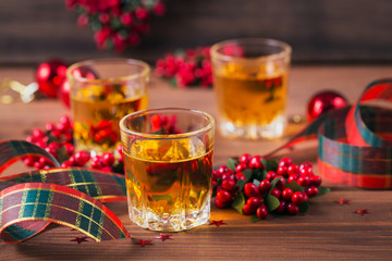 Whiskey, brandy or liquor shot and Christmas decorations Fototapete
