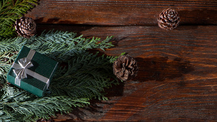 New Year's background with gifts, conifer branches.