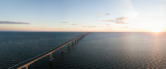 Aerial Panoramic view of Confederation Bridge to Prince Edward Island during a vibrant sunny sunrise. Taken in Cape Jourimain National Wildlife Area, New Brunswick, Canada. Wall mural
